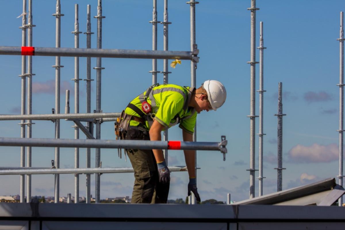Advanced Scaffolding Man on Roof